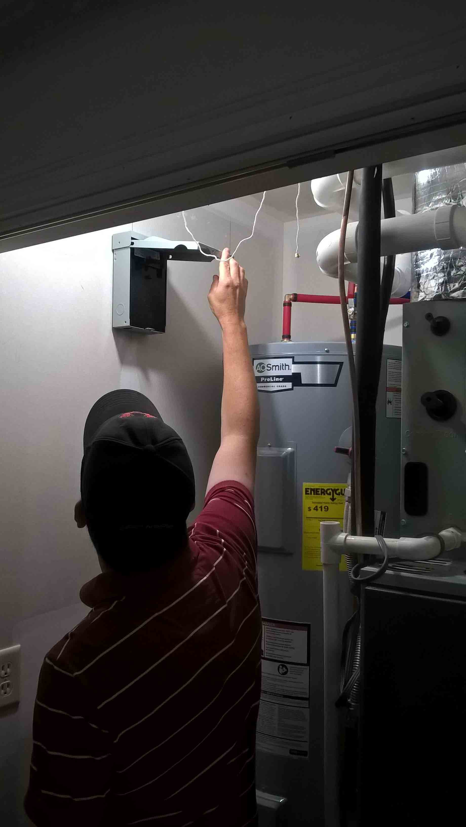 Building Inspector Checking Electrical Panel