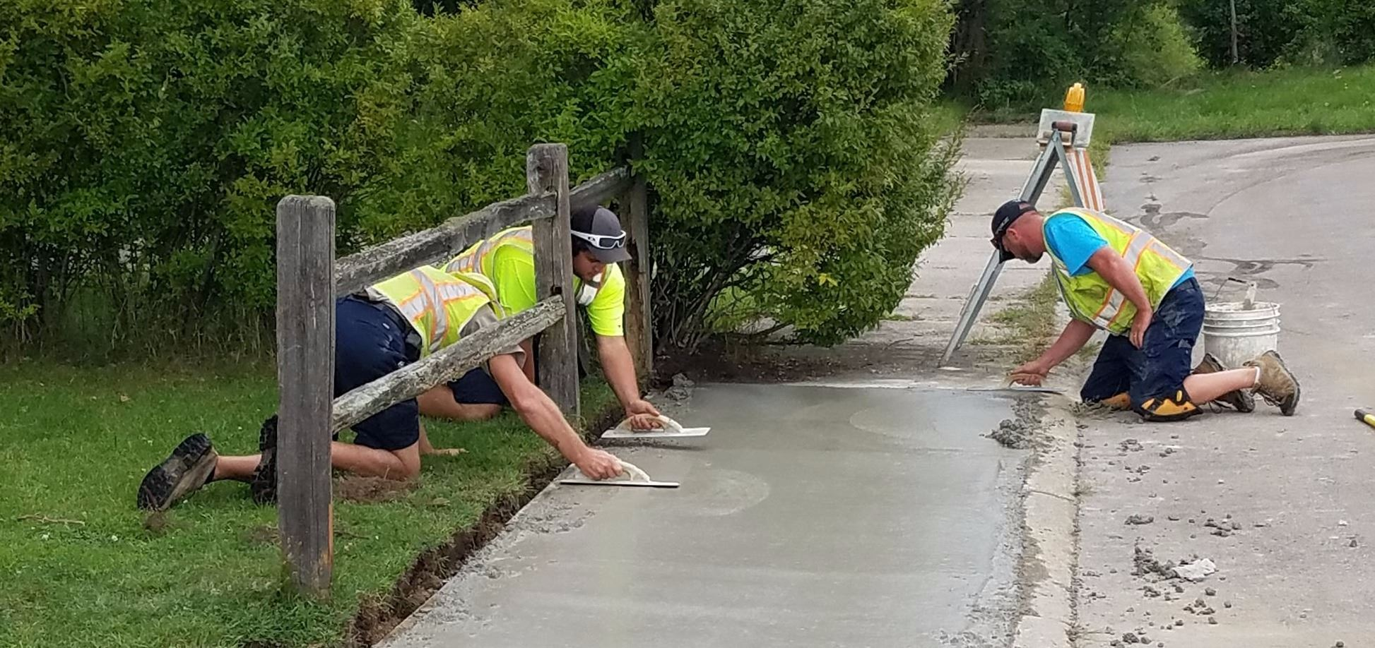 Crew replacing sidewalk